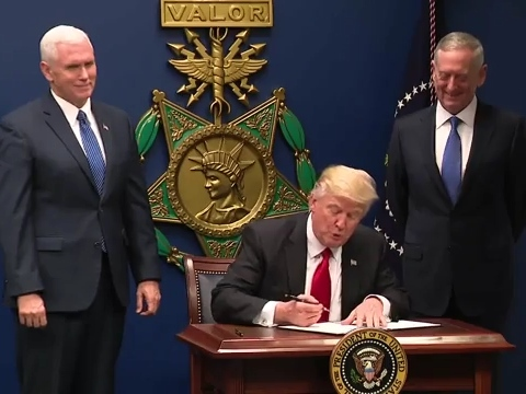 President Donald Trump signing