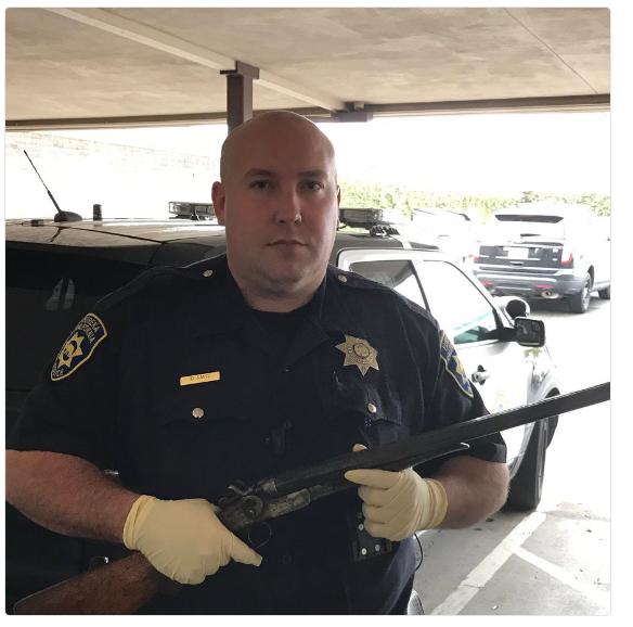 Officer holding stolen gun