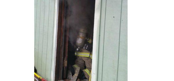 smoke billowing behind fireman