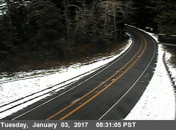 Two lane hwy dusting of snow