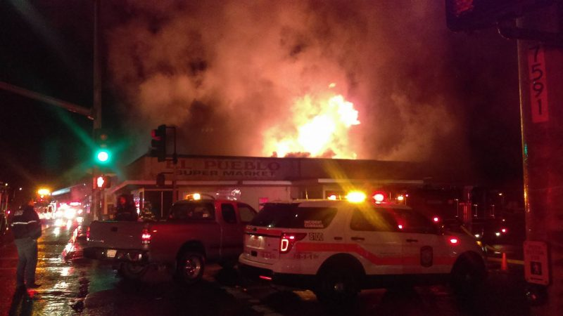 Firefighters Fighting fire in a business
