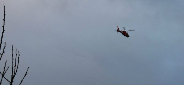 A helicopter searches Humboldt Bay this morning. [Photo by Kym Kemp]