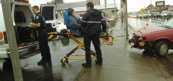 Patient being wheeled to ambulance by Stormy Taylor
