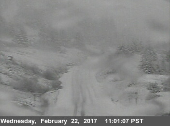 snow on country highway traffic cam
