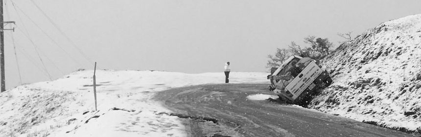 Truck slid off road snow