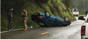 Blue sedan flipped on its roof
