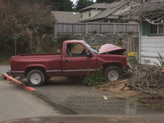 Red pickup crashed into a yard.