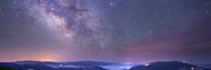 Milky Way and greenhouses lighting the Humboldt skyline.