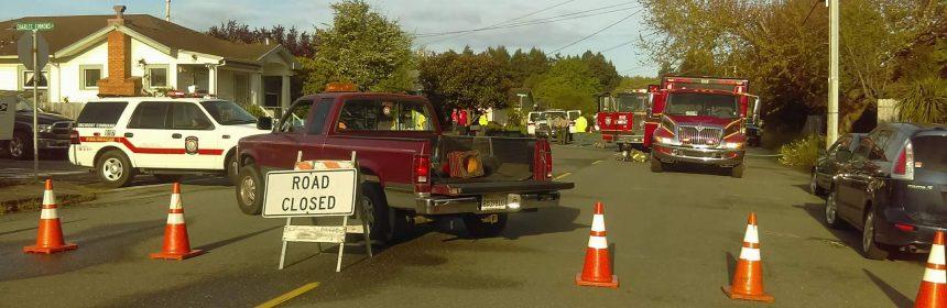 Firefighters block off street.