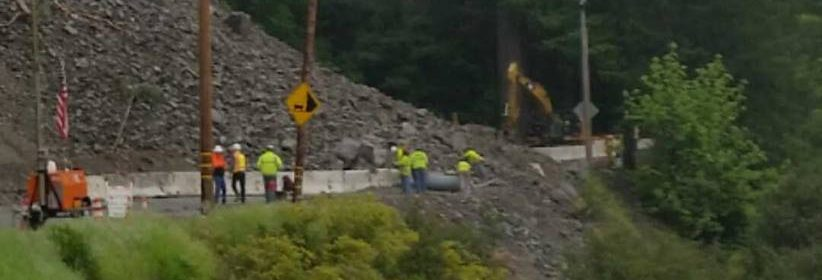 Workers at a rock slide blocking a road