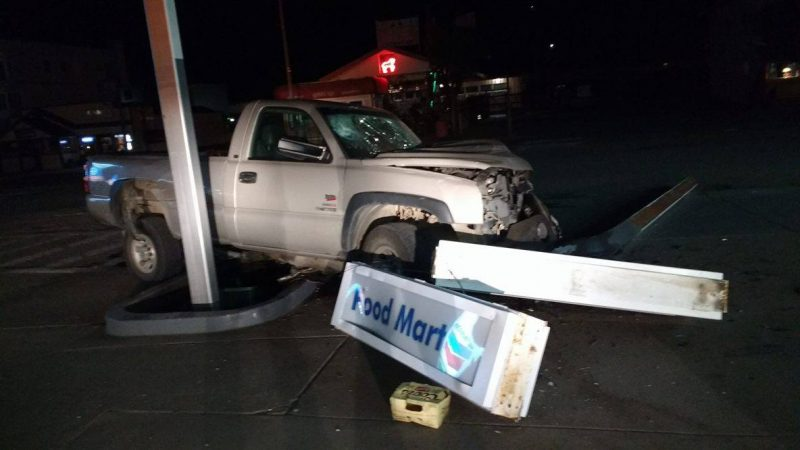 Pickup hits gas station sign
