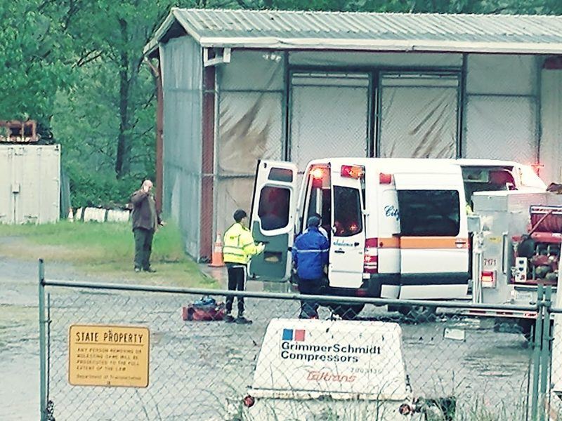 Ambulance ready to carry away the shooter.