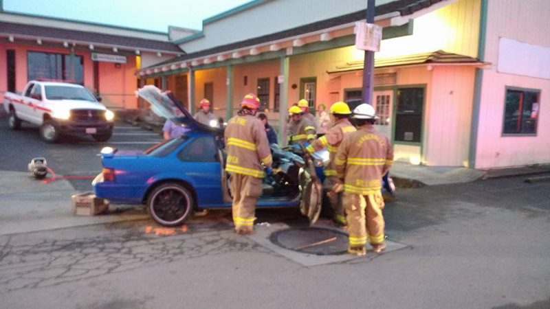 Firefighters surround car after extricating driver