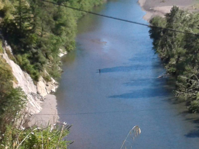 Man wading river