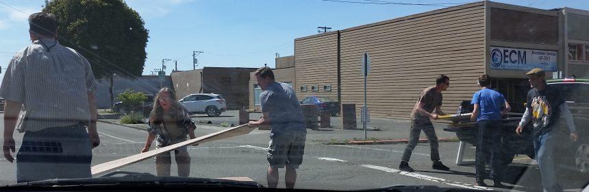 Good Samaritans help gather a pickup load of plywood
