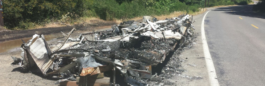 Remnants of last night's camp trailer fire