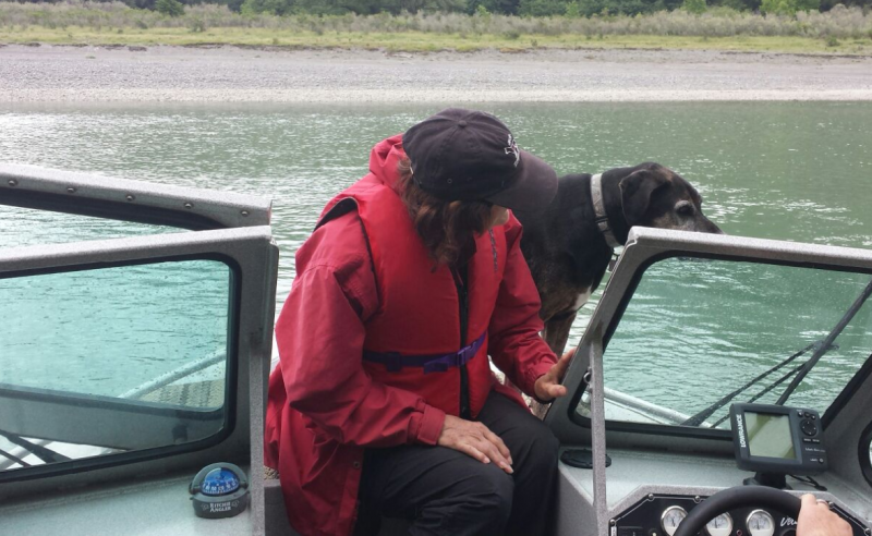 Dog handler and cadaver dog on the water