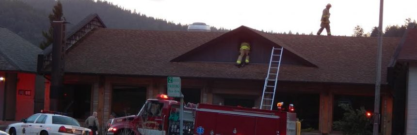 Firefighters on a building
