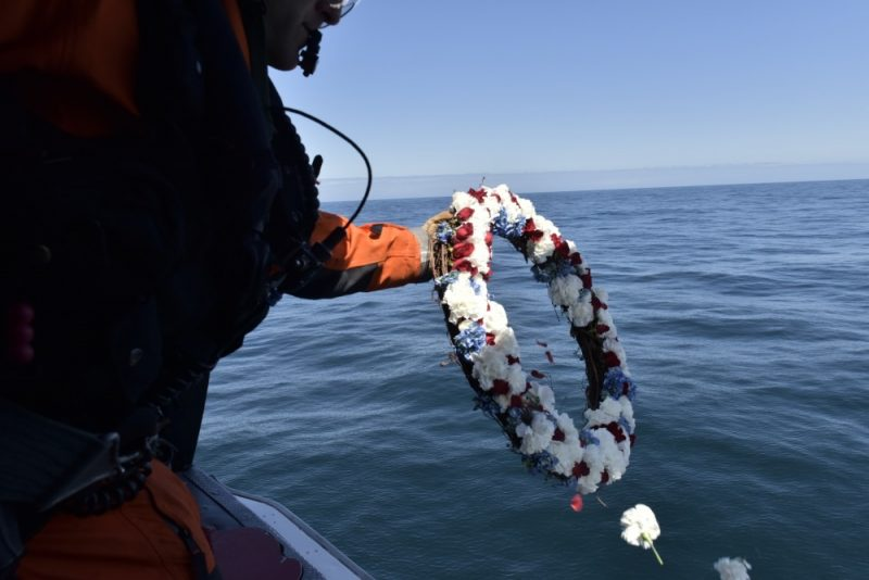 Petty Officer 1st Class Jeffry Moeschler, an avionics electrical technician assigned to Coast Guard Air Station Humboldt Bay, lays a wreath at sea west of Cape Mendocino, in remembrance of a Humboldt Bay flight crew that died in a helicopter crash 20 years ago during a search-and-rescue mission. Two pilots and two crewmembers lost their lives aboard a Coast Guard MH-65 Dolphin helicopter during an effort to save five mariners stranded on a Canadian sailing vessel during a storm. U.S. Coast photo by Petty Officer 3rd Class Sarah Wilson.
