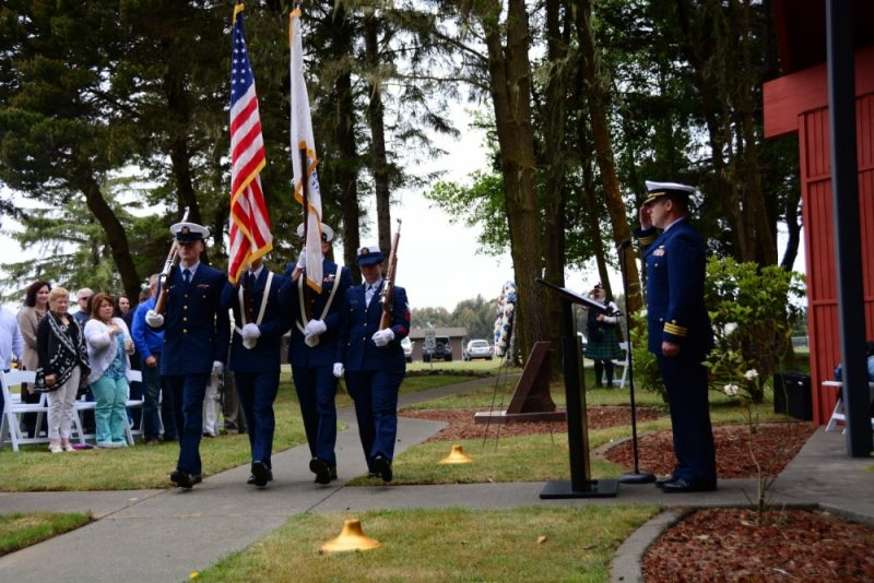 A ceremonial color guard team at Coast Guard Sector Humboldt Bay presents colors before a memorial service held in remembrance of the crew and passengers of the CG-6549 helicopter that crashed 20 years ago during a search-and-rescue mission. Lt. Jeffrey F. Crane, 35, of Marshfield, Massachusetts; Lt. j.g. Charles W. Thigpen IV, 26, of Riverside, California; Aviation Machinist's Mate Petty Officer 3rd Class Richard L. Hughes, 33, from Black Canyon, Arizona; and Aviation Survivalman Petty Officer 3rd Class James G. Caines, 26, of Hinesville, Georgia, died in the line of duty. U.S. Coast Guard photo by Seaman Alex Gray.