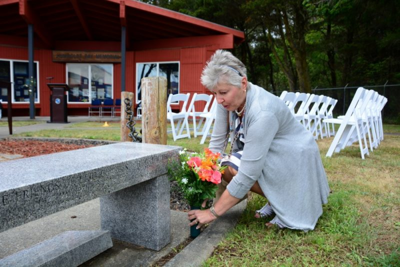 The mother of Lt. j.g. Charles Thigpen IV places flowers at the Humboldt Bay Memorial before a memorial ceremony at Coast Guard Sector Humboldt Bay, June 8, 2017. Thigpen was one of four crewmembers lost in the line of duty 20 years ago when the MH-65 Dolphin helicopter CG-6549 crashed 57 miles west of Cape Mendocino, Calif., during a search-and-rescue mission to save five sailors in a storm. U.S. Coast Guard photo by Petty Officer 3rd Class Sarah Wilson.