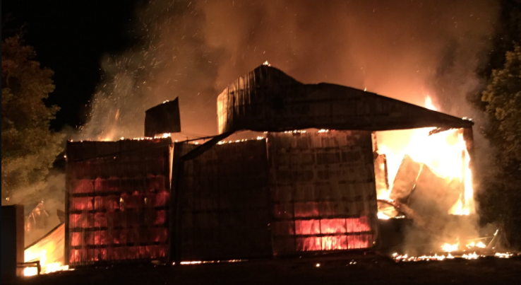 A commercial building burns