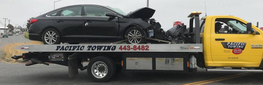 Wrecked car on Flatbed