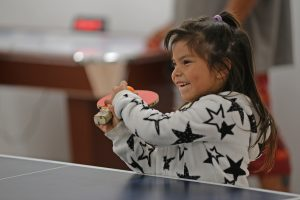 Yurok girl playing ping pong