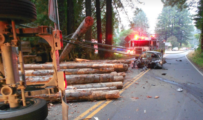 car and Logging truck accident