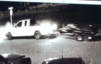 White truck pulling jet skis on  surveillance camera