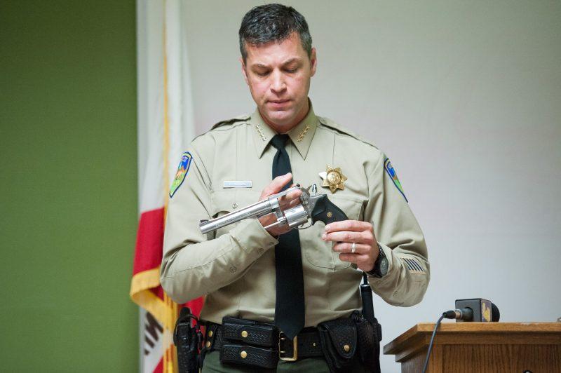 Billy Honsal holding a gun