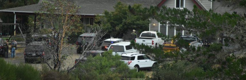 Law enforcement raiding a home