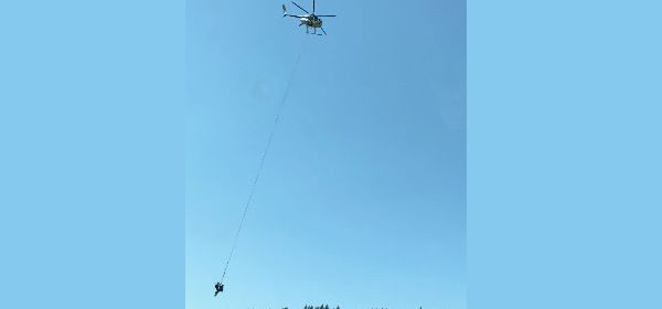 Helicopter towing two officers