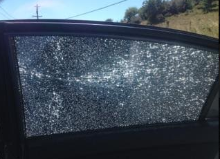 window shattered by bullet