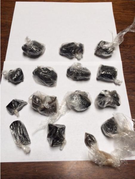 13 ounces of black tar heroin