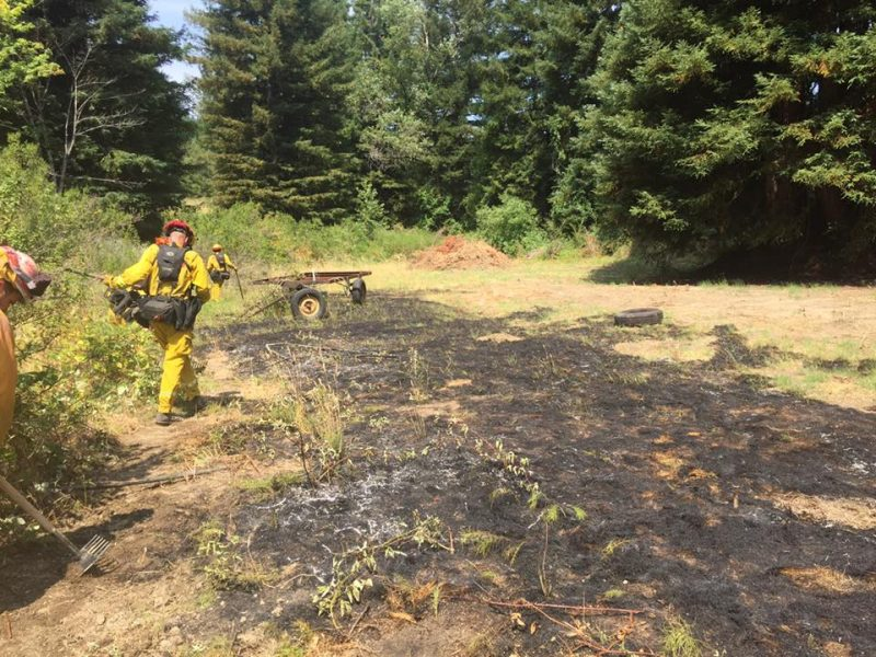 Salmon Creek Fire helps put out the flames.