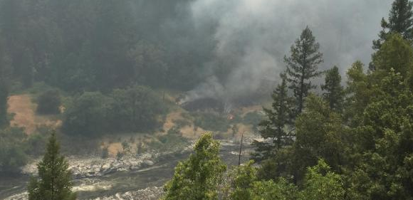 The Ukonom Fire seen backing down a hillside to the Klamath River from State Highway 96 on Saturday, August 5, 2017. Kathy Hard/NorCal Team 1