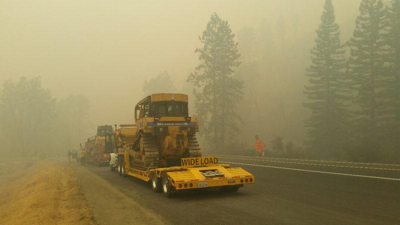 Smoke smothers the road as heavy to fight the Helena Fire.
