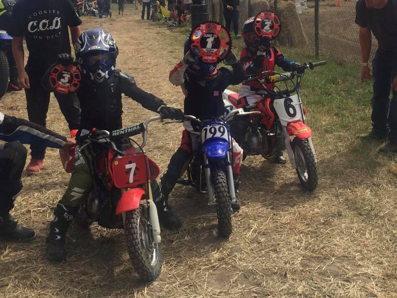 Kids racing motorcycles.