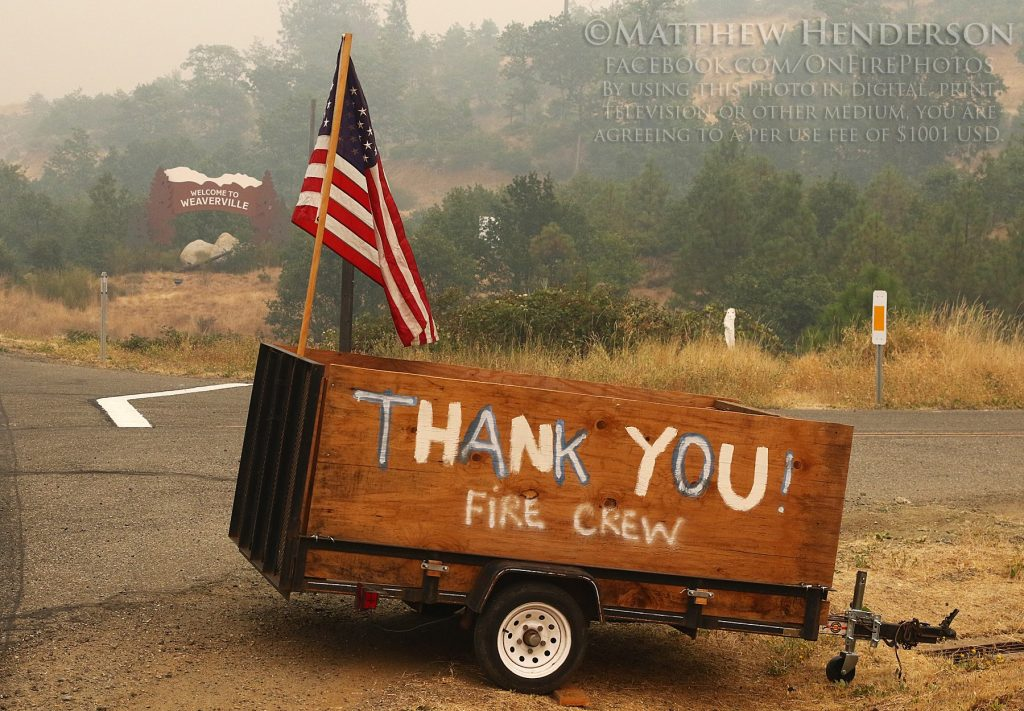 Thank you to firefighters with American Flag