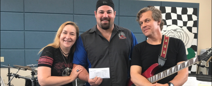 Lonny Whitlow middle presents a check to the South Fork High [