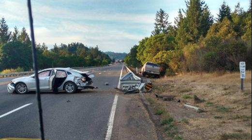 A silver sedan believed to be a rental vehicle and a pickup were involved in a crash