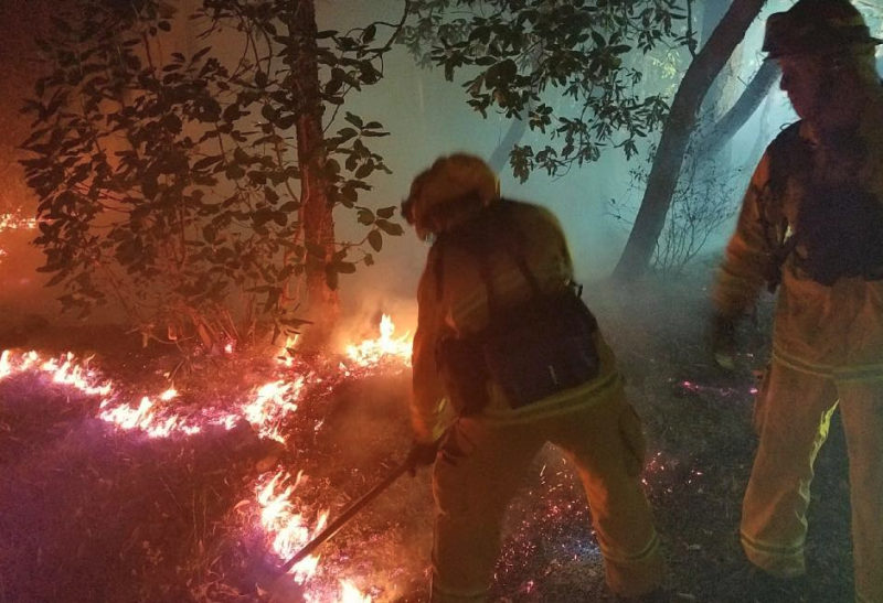 Firefighters from the Mountain View Fire Department help fight flames.