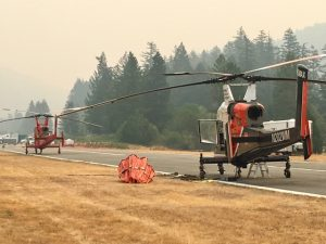 Smoke around fire helicopters