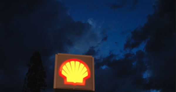 Shell gas station sign on stormy night
