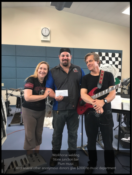 Lonny Whitlow in the middle presents an envelope full of cash to the South Fork High's music program Saundra Stephenson and Paul Schmollinger.