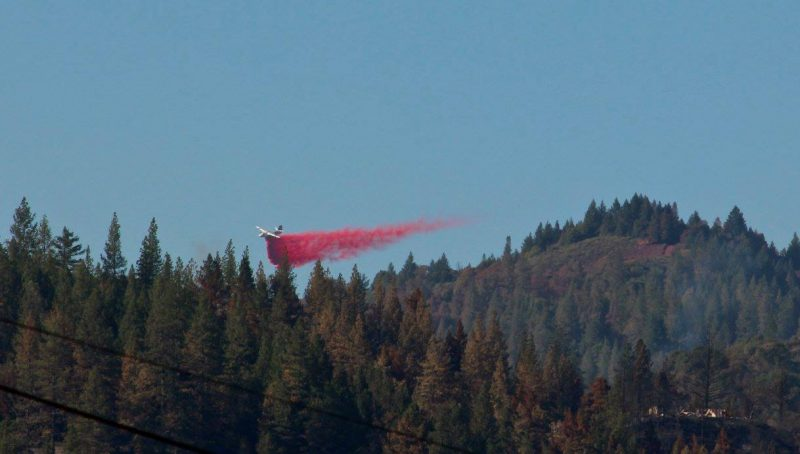 Plane dropping retardant in the hills above Potter Valley