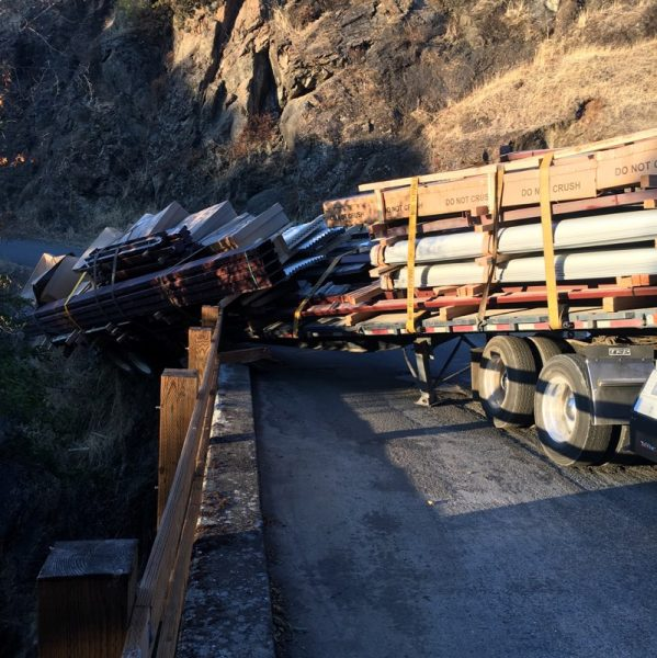 A trailer hangs over the edge after a semi gets stuck on Dobbins Creek Bridge...again.