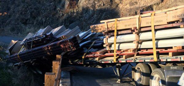 A trailer hangs over the edge after a semi gets stuck on Dobbins Creek Bridge...again.