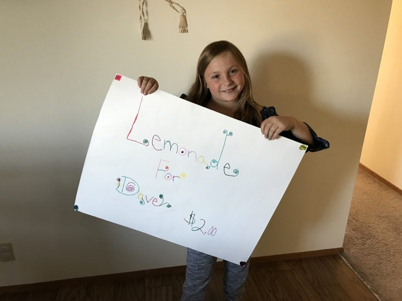Amaya Diamond holding a sign for her stand. [All photos provided by Nicole Dahl]